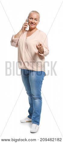 Senior woman speaking on cell phone, isolated on white