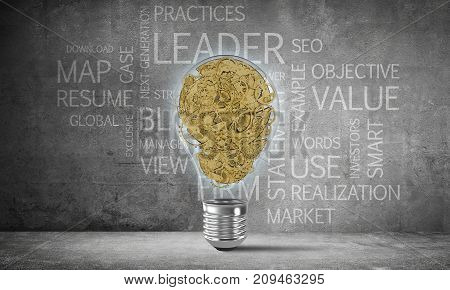 Glass lightbulb with multiple gears inside placed against business related terms on grey wall on background. 3D rendering.