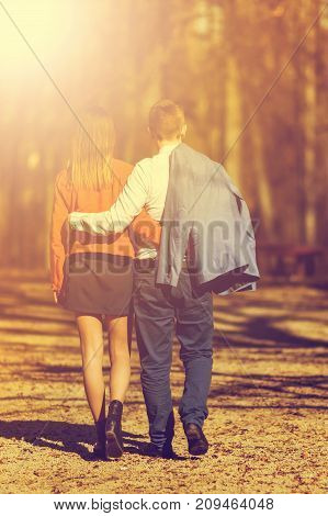 Happy Young Couple In Love Walking In The Park In Autumn. Vintage Tone