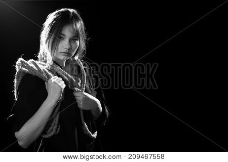 woman executioner with wrap on black background, monochrome