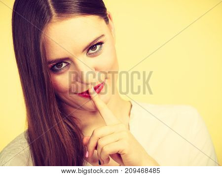 Mysterious Woman Showing Silence Gesture With Finger