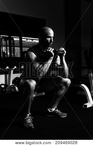 Legs Exercise With Dumbbells In A Gym