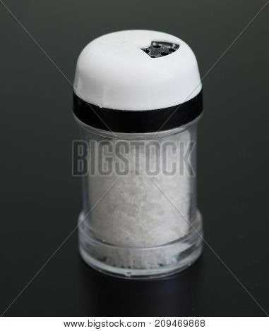 image of salt shaker on a black background