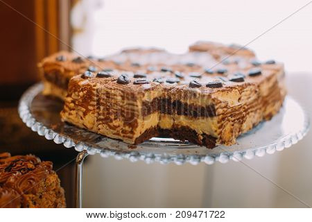 Close-up view of the delicious cake placed on the wedding dessert stand