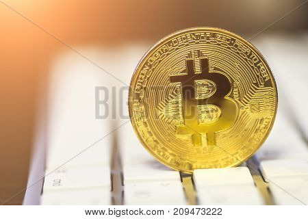 Golden bitcoin on keyboard, symbol of crypto-currency and electronic internet banking and new money, toned, selective focus, copy space