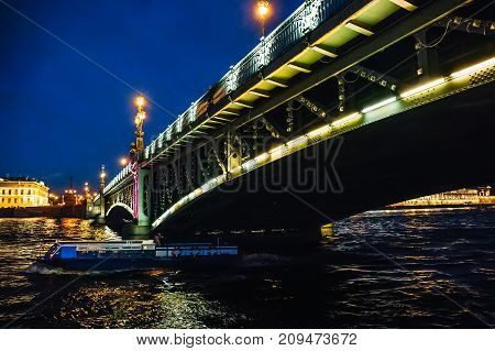 Landscape with bridge at night, view from Neva river in St. Petersburg, Russia, toned