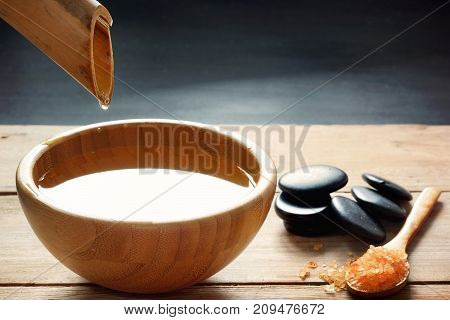 A Set For Spa Procedures, Massage Stones, Bath Salts And Flavored Water, Collected From A Bamboo Ste