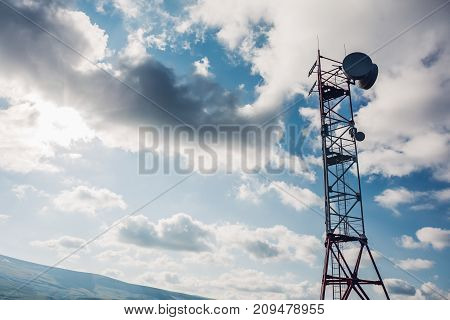 Satellite dish telecom network antenna tower at sky background, communication technology network concept