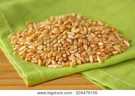 Pile of wheat grass seeds for sprouting on table