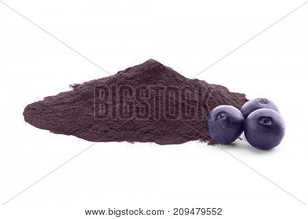 Acai powder and berries, isolated on white