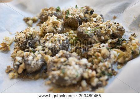 stuffed cultivated mushrooms and gratineed in oven