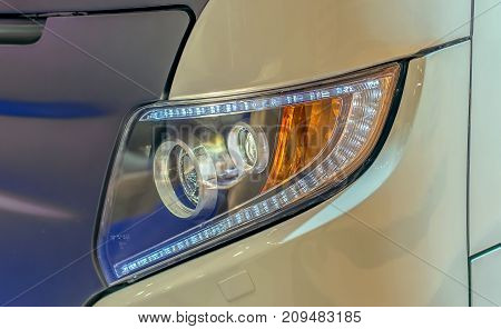headlight and turn signal from a sports car close up