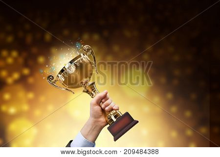 Holding gold golden trophy hand sport competition