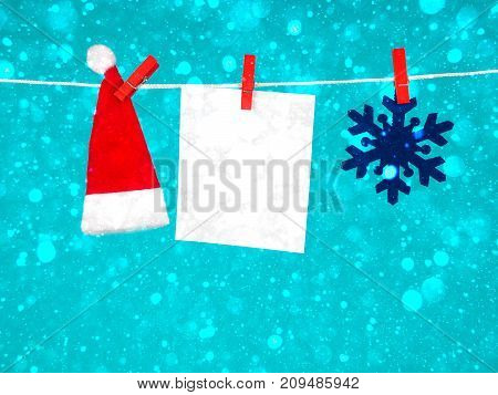 Christmas Decorations, Santa Claus Hat , Blank For Text And Snowflake On The Clothespin