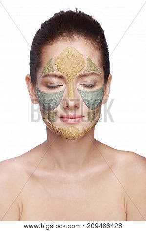 portrait of a girl with a cosmetic mask on her face