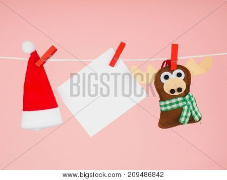 Christmas Decorations, Santa Claus Hat And Reindeer On The Clothespin