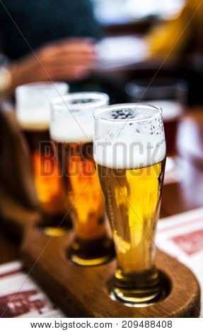 Glass of beers on wooden table, alcohol, cold