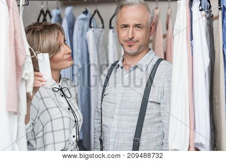 Woman Showing Tag To Man