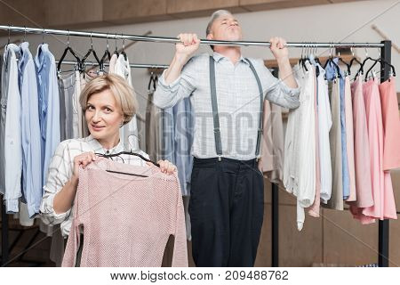 Man Pulling Up On Clothes Rack
