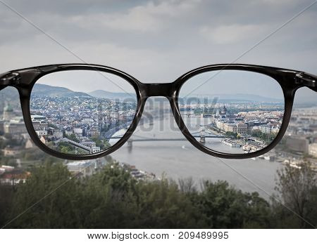 Clear Vision Through Glasses Over City Landscape