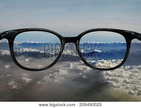 Clear Vision Through Glasses On Blue Clouds Landscape