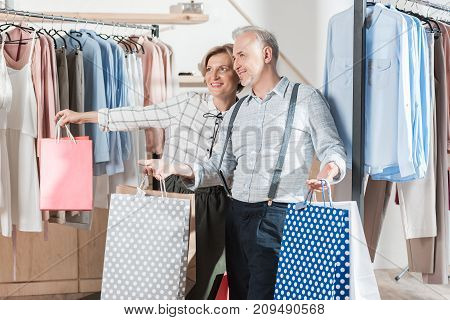 Woman And Man Standing With Shopping Bags