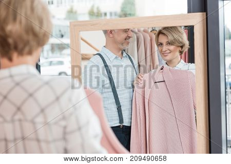 Woman Choosing Pink Shirt