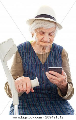 Senior woman holding a mobile phone in her hand