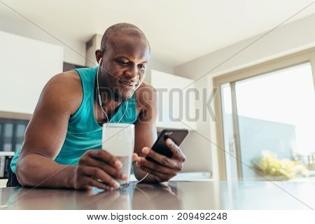 Man Enjoying Music At The Breakfast Table