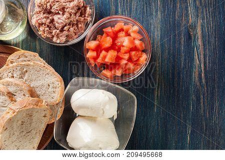 Ingredients Ready For Preparing Bruschetta With Tuna, Mozzarella