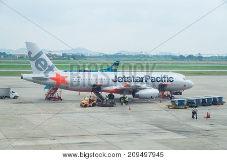 Hanoi, Vietnam - August 19, 2015: Jetstar Pacific Airbus A320 on the tarmac at Hanoi airport. Jetstar Pacific is a Vietnamese budget airline co-owned by Qantas.