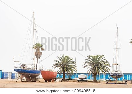 WALVIS BAY NAMIBIA - JULY 1 2017: Yachts on dry land at the yacht club in Walvis Bay on the Atlantic Coast of Namibia
