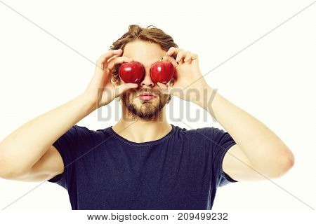 Young Bearded Man In Blue Tshirt Holding Apples As Eyes