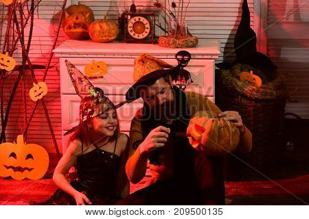 Wizard And Little Witch In Hats Carve Jack O Lantern