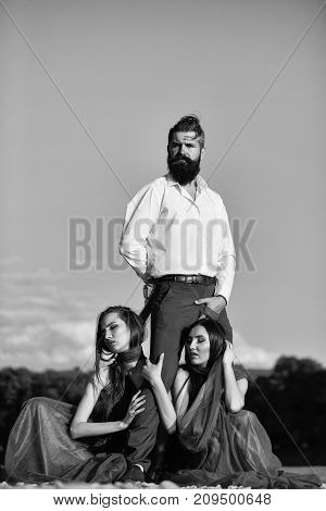Bearded Man And Two Women Outdoor