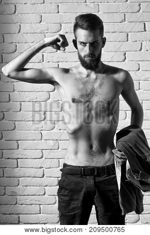 Slim Bearded Man With Thin Bare Torso On Brick Background
