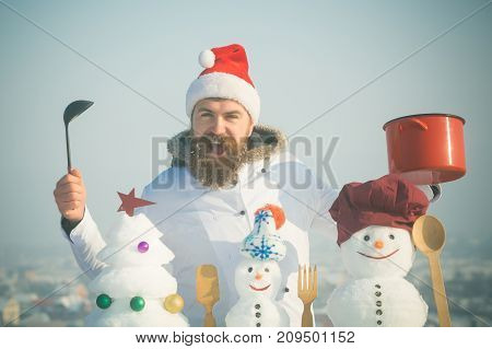 Excited Man In Santa Hat And Uniform On Winter Day