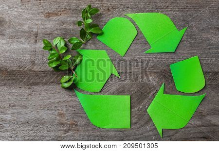 Symbol of recycling on wooden background