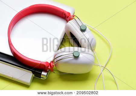 Electronics Isolated On Yellow Background. Music And Digital Equipment Concept