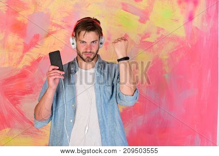 Musical Lifestyle. Blue Eyed Stylish Hipster With Smartphone.