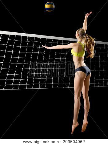 Young woman beach volleyball player (with ball and net version)