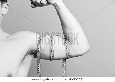 Muscles Isolated On Light Purple Background With Copy Space.