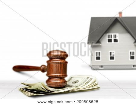Model wooden little house gavel background close-up