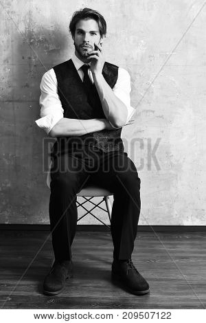 Serious Fashion Business Man Sitting On Chair
