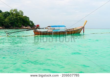 Wooden Boat On The Clear Turquoise Sea Water