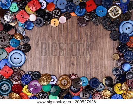 Wooden Background With Old Fashion Assorted Buttons With Copy Spase