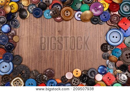 Wooden Background With Old Fashion Assorted Buttons