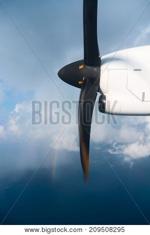 Running Turbo Airplane Propeller In Blue Sky With Rainbow