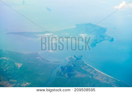 Aerial View Of The Tropical Island In Blue Sea Water