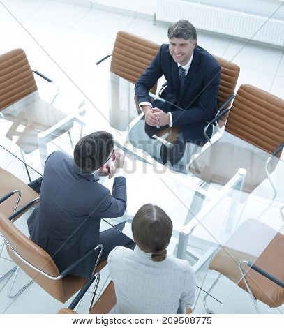 conversation of business people in a modern meeting room
